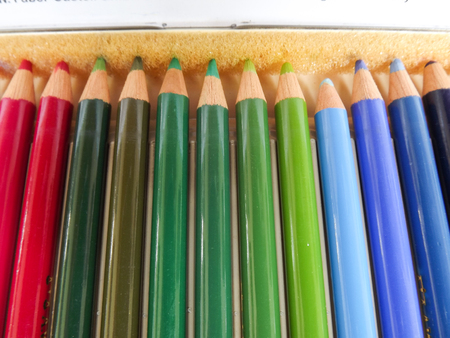 lining up: colored pencils lining up in the box Stock Photo