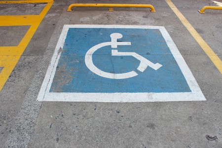 spot: Handicapped parking spot symbol on the ground