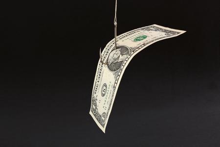 Money bait in a black background