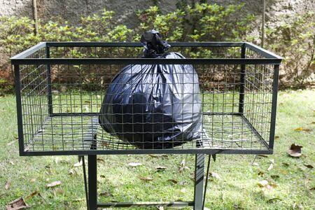 consumerism: Trash bag on the trash tray Stock Photo
