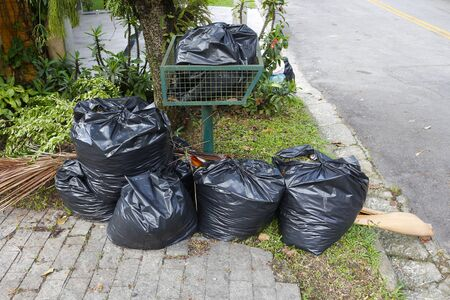 consumerism: Trash bags piled up