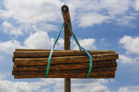 Lumber wood hanging from a pole