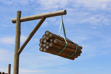 Lumber wood hanging under the pole