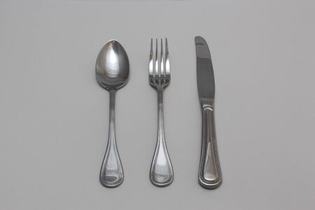 Metallic silverware - fork, knife and spoon Stock fotó