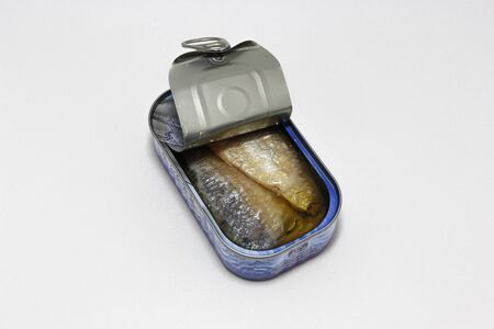 Canned fish (sardines) on white background.