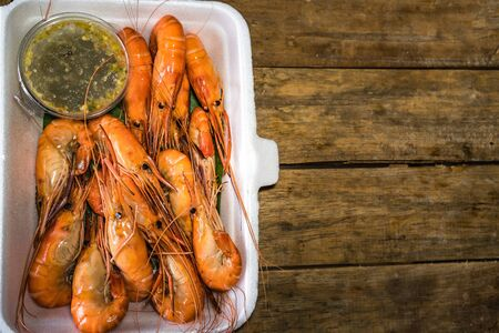 Grilled shrimp in hot box with seafood Stock Photo