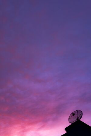 Evening sky view with antennas in the roof of the house. (can you hear me) Banco de Imagens