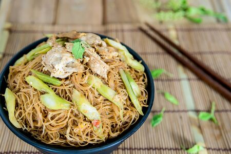 Fried noodle with pork appetizing placed on the dining table. Stock Photo