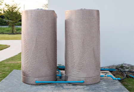 Storage tank water one pair. Use filter to increase the chlorine in the pool. Stock Photo