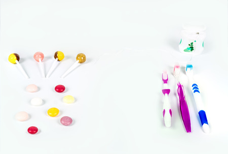 Group of colorful candy and a group of toothbrush that can maintain the oral cavity. The sweetness of sugar causes tooth decay. And used for studies on oral health and teeth.