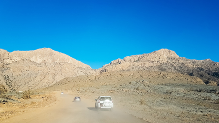 Travel by car and adventure through the dust to the mountain. To visit Oman country landscape. Stock Photo