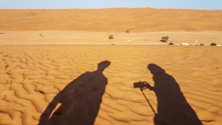 Shadow of a man and womans photography travel in the desert. While tourism and to keep the memories and remove them. Stock fotó