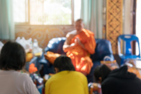The image and blur of people travel to merit of Buddhists.While the purpose is to the faith of Buddhism with long and used as the background.