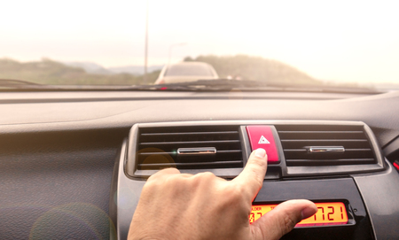 The fingers are about to press the button.And to open the contract emergency lights that are in your car.And to serve as a symbol or ask for help. Stok Fotoğraf