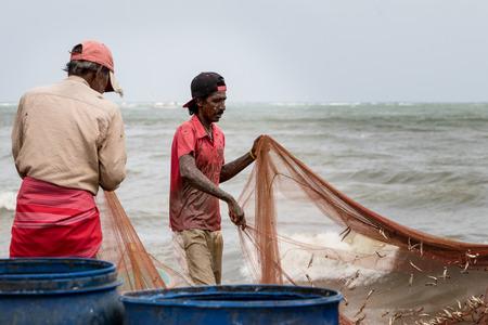 fisherman at Negombo fishmarket, Sri Lanka