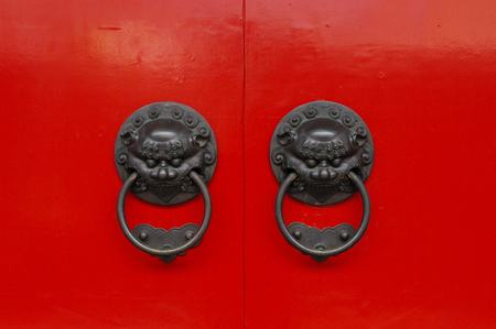 Chinese Door Knockers on Red Door