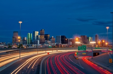 Denver Skyline at dusk with car trails along Interstate 25 in Colorado 写真素材