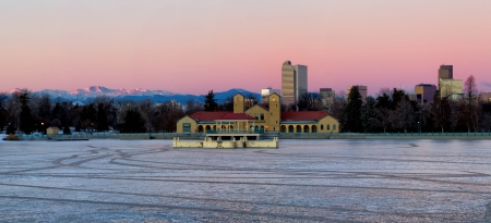 denver city park: Eary morning sunrise on Denver City Park in the winter with a frozen lake Stock Photo