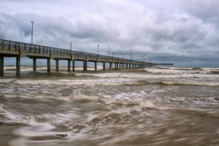 horace: Horace Caldwell Pier in Port Aransas Texas as a storm is coming in Stock Photo