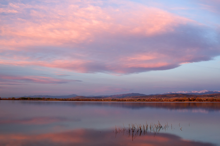front range: Sunrise Clouds over a Colorado Lake with the front range and the Indian Peak Wilderness in the distance Stock Photo