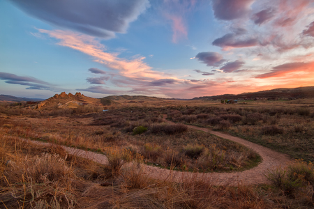 the backbone: The dirt trail that leads around the popular hiking area of Devils Backbone. The sky exploded with color as the sun hits the clouds