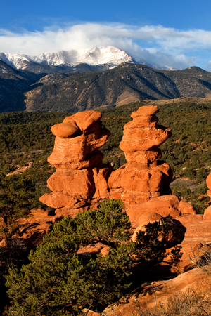Pikes Peak overlooking the rock formations at Garden of the Gods, Colorado