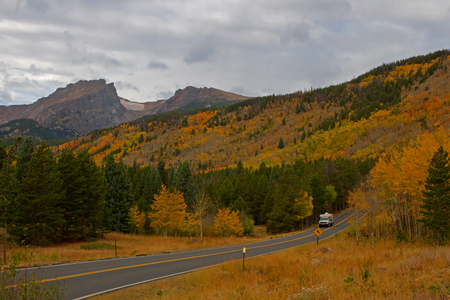 bear lake: A Camper travels along Bear Lake Road in Rocky Mountain National Park in the fall season