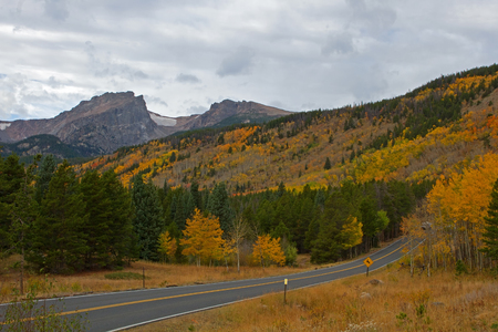 bear lake: Bear Lake road winds up the hillside on an autumn day in Rocky Mountain National Park Stock Photo