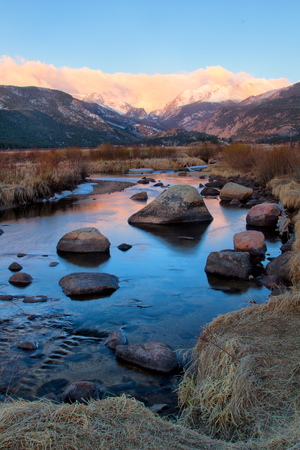continental united states: Clouds form over the continental divide in Rocky Mountain National Park as the Big Thompson River starts flowing in the spring run off