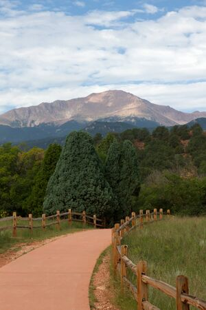 paved: The view of Pikes Peak from a paved trail in the central garden at Garden of the Gods Stock Photo