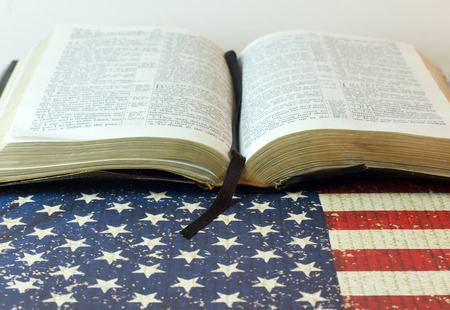 room for copy: An old Bible with a July 4th background and an American Flag with room for copy space