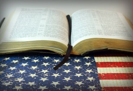 An old Bible with a July 4th background and an American Flag with room for copy space