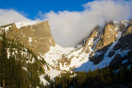 rocky mountain national park: Clouds swirl over Hallett and Flattop peaks in Rocky Mountain National Park in Estes Park Colorado Stock Photo