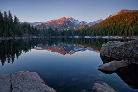 longs peak: Longs Peak reflects in the still waters of bear Lake In Rocky Mountain national park