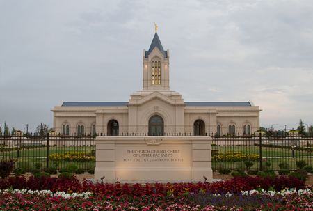 fort collins: The Fort Collins Colorado Temple at sunrise on a cloudy day. The Church of Jesus Christ of Latter-Day Saints Temple in Fort Collins Colorado newly bulit Temple lit in the morning light Stock Photo