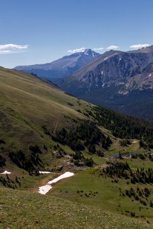 longs peak: Longs Peak stands tall above Trail Ridge Road in Rocky Mounain National Park on a summers day