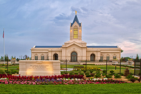 lds: The Fort Collins Colorado Temple at sunrise on a cloudy day. The Church of Jesus Christ of Latter-Day Saints Temple in Fort Collins Colorado newly bulit Temple lit in the morning light Stock Photo