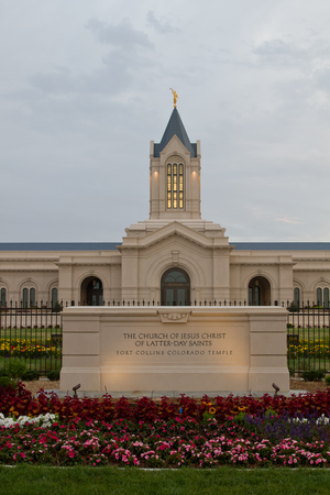 collins: The Fort Collins Colorado Temple at sunrise on a cloudy day. The Church of Jesus Christ of Latter-Day Saints Temple in Fort Collins Colorado newly bulit Temple lit in the morning light Stock Photo