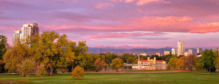 denver parks: Gorgeous sunrise on Denvers City Park. leaves are starting to turn in this autumn season. Fresh snow on Mt Evans and the front range Stock Photo