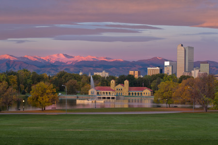 denver skyline with mountains: Fall Sunrise on Denvers City Park with the alpine glow on Mt Evans and the front range in Colorado Stock Photo