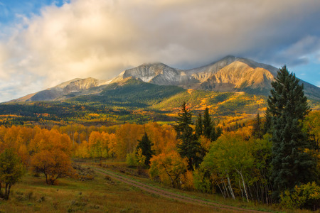 The clouds lifted on this autumn morning to reveal the beautiful peaks of Mt Sopris in Carbondale, Colorado Фото со стока - 63508793