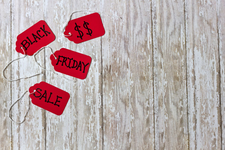 white washed: Red Black Fraday Sales Tickets on a white washed wood background with room for copy space or negative space