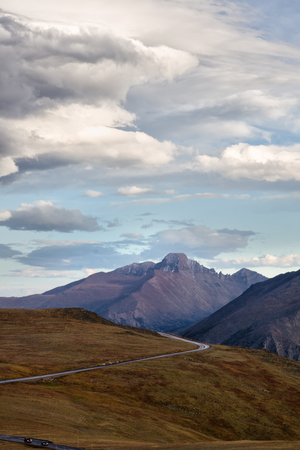 longs peak: A storm blows over Rocky Mountain National Park. Longs Peak can be seen along Trail Ridge Road