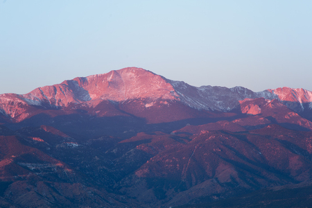 photgraphy: The summit of Pikes Peak glows in the morning sunrise. Pikes Peak is located in Colorado Springs, Colorado and in the county of El Paso