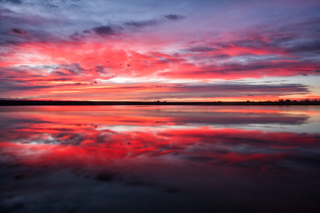 Goregous colorful sunrise on a lake in Colorado Stock Photo