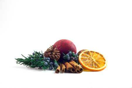 potpourri: Cinnamon Sticks surrounded by potpourri , orange slices, pine branches, berries, and nuts isolated on a white background