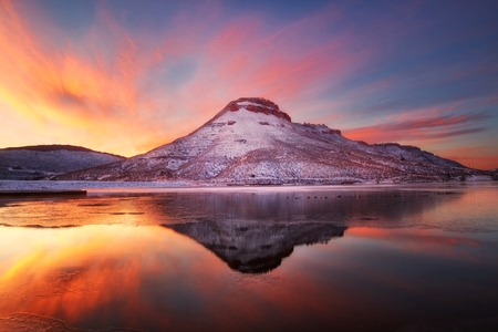 Winter sunrise on the Flatiron Reservoir located in Loveland Colorado Stock Photo