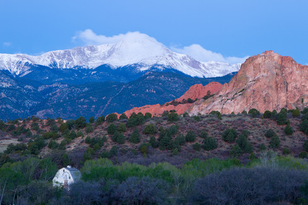 Pre Dawn image of Pikes Peak Mountain and Garden of the Gods in the springtime with the Rock Ledge Barn in the foreground