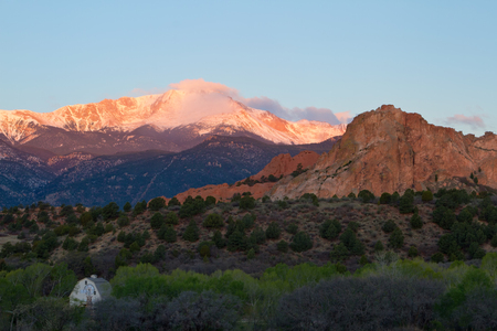 Sunrise image of Pikes Peak Mountain and Garden of the Gods in the springtime with the Rock Ledge Barn in the foreground