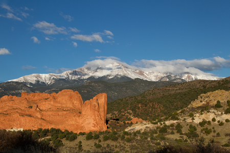 Pikes Peak and Garden of the Gods on a Spring or summer Day with clouds rolling over the mountain top Stock Photo